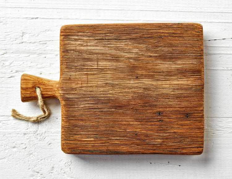 55152541 - cutting board on white wooden table, top view
